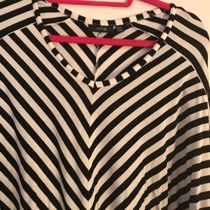 V neck tunic top.   Washed but never worn